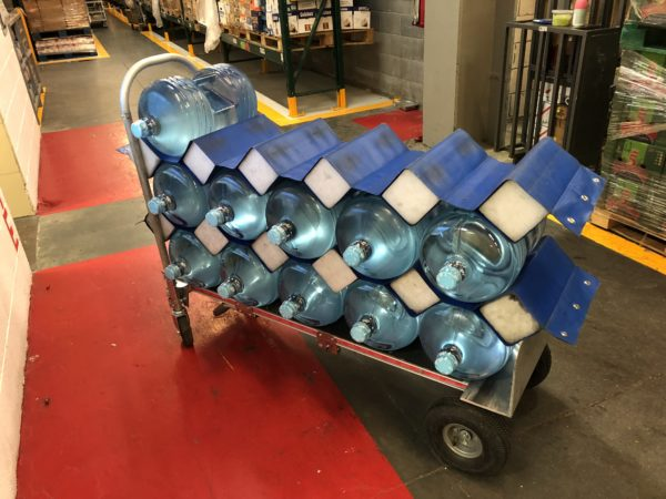Bottle hammock in use in storage area of a warehouse